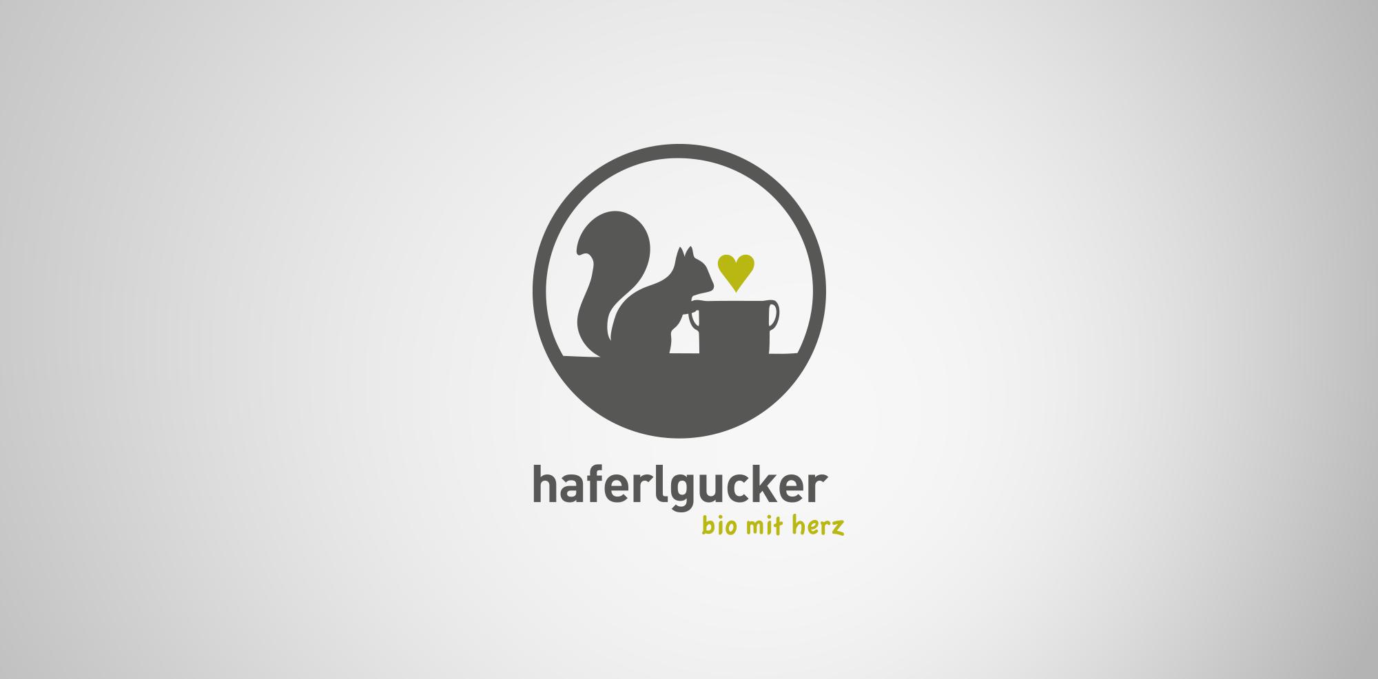 """Logo """"haferlgucker"""" für die Lebensmittelbranche: Scherenschnitt Eichhörnchen sitzt vor Tasse"""